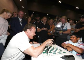 Arnold Plays chess with a young contender